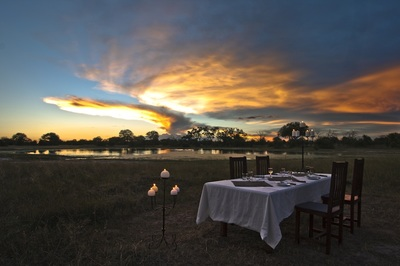 Dining al fresco at Bomani Tented Camp, Hwange, Zimbabwe