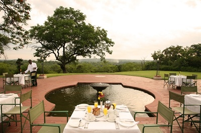 Dining around the water feature, Victoria Falls Hotel